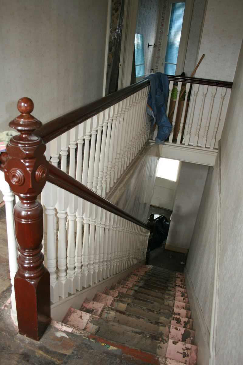 Down main stairs